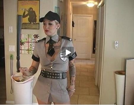 tattooed punk rock chick in cop uniform