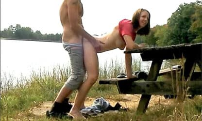 Couple caught fucking on a picnic table in a public park