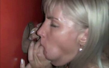 Blonde HotWife Gives a Sloppy Blowjob at the Porn Booth Glory Hole