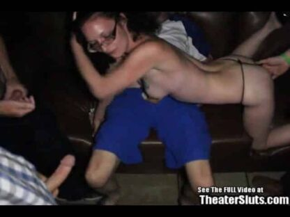 Nerdy girl in glasses gangbanged in porno theater