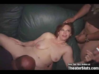 Tattooed redhead gangbanged in adult theater