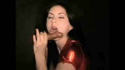 Woman in red dress licks dick at gloryhole