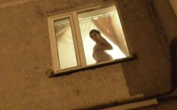 Girl In Window Knows a Voyeur is Watching Her Undress - Free Video